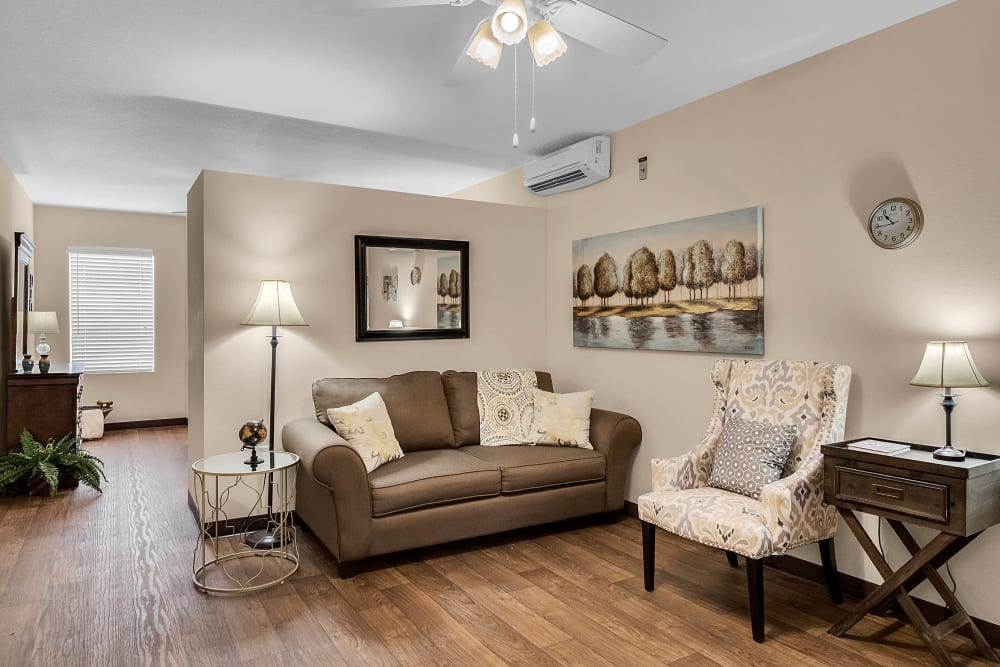 Model living room at {location_name}} in Brooksville, Florida