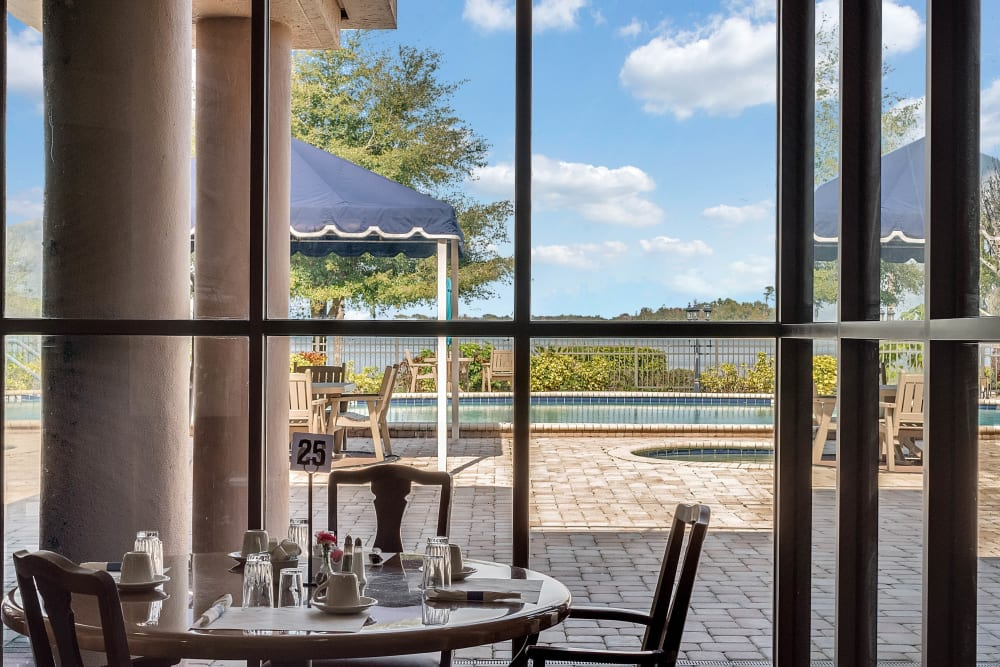 Dining area with view of lake at Spring Haven in Winter Haven, Florida