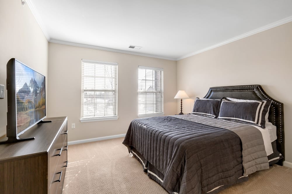 An apartment bedroom at Singh Apartments in Michigan