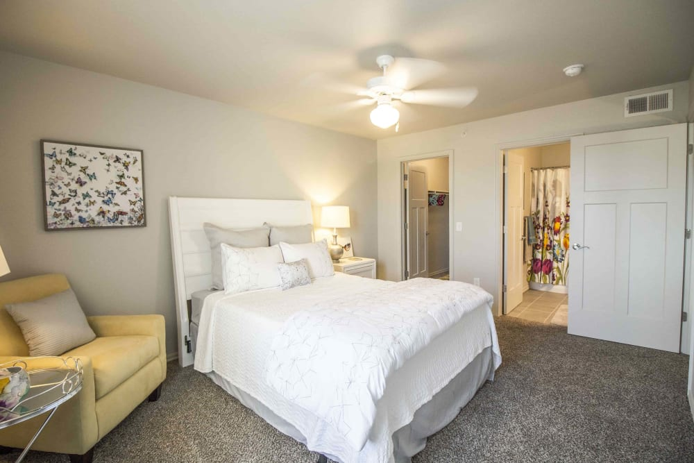 A master bedroom with an attached bathroom at Legacy Trail in Norman, Oklahoma