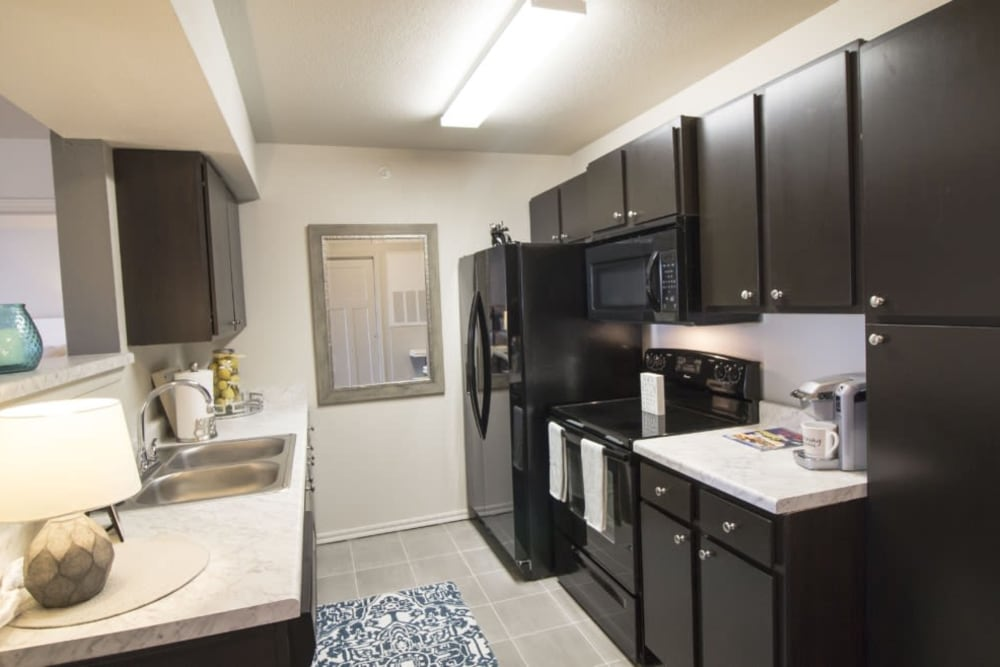 A kitchen in a model apartment at Legacy Trail in Norman, Oklahoma