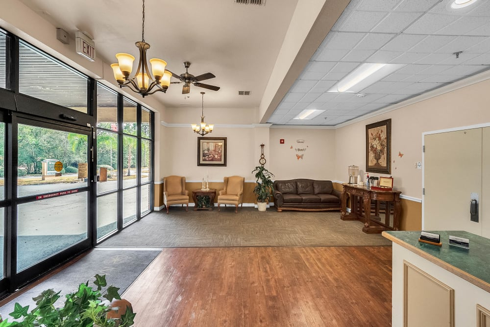 Entrance with couches and reception desk at Spring Oaks