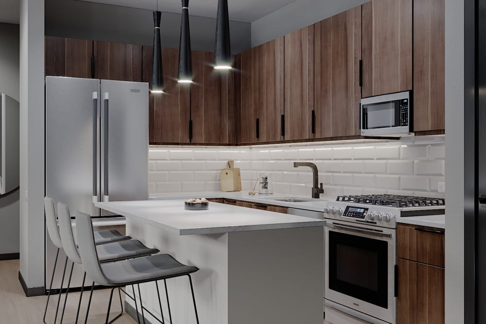 Kitchen with stainless steel appliances at Solana Stapleton Apartments in Denver, Colorado