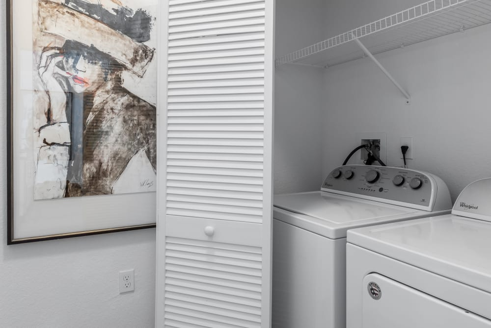 Washer and dryer area in on of Our Cozy Apartments in Riverview, Florida