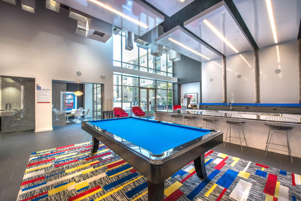 Billiards table and much more in the expansive game room at Olympus at Ross in Dallas, Texas