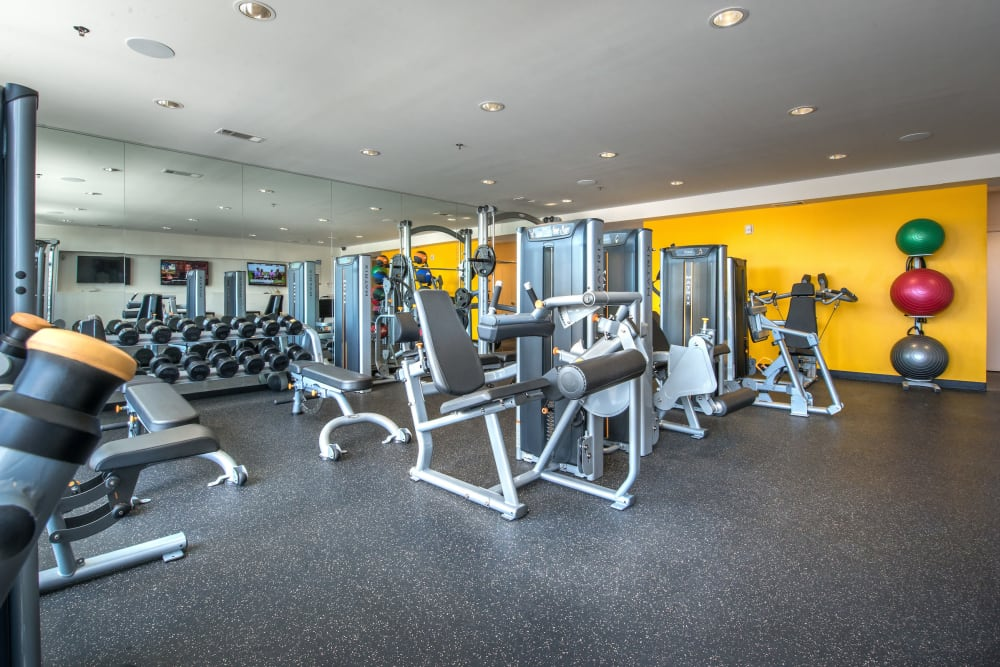 Well-equipped onsite fitness center at Olympus at Ross in Dallas, Texas