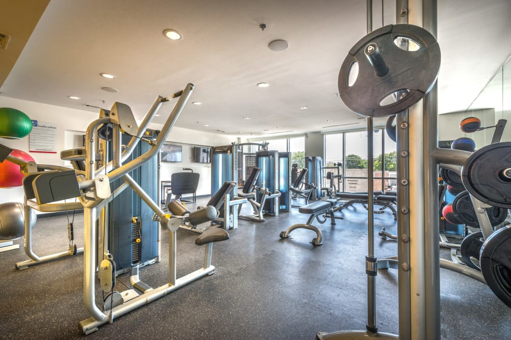 Very well-equipped fitness center at Olympus at Ross in Dallas, Texas