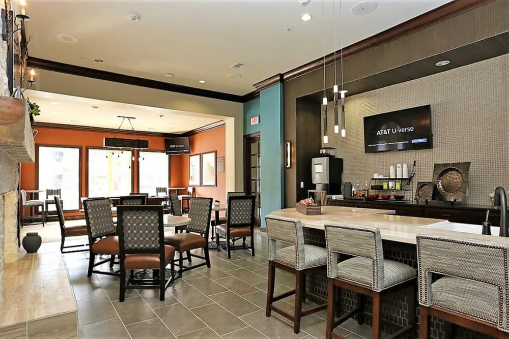 Spacious resident club with bar seating at Trails at Lake Houston in Houston, Texas
