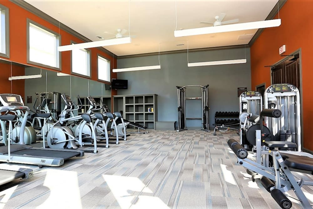 Gym with plenty of individual workout stations at Trails at Lake Houston in Houston, Texas