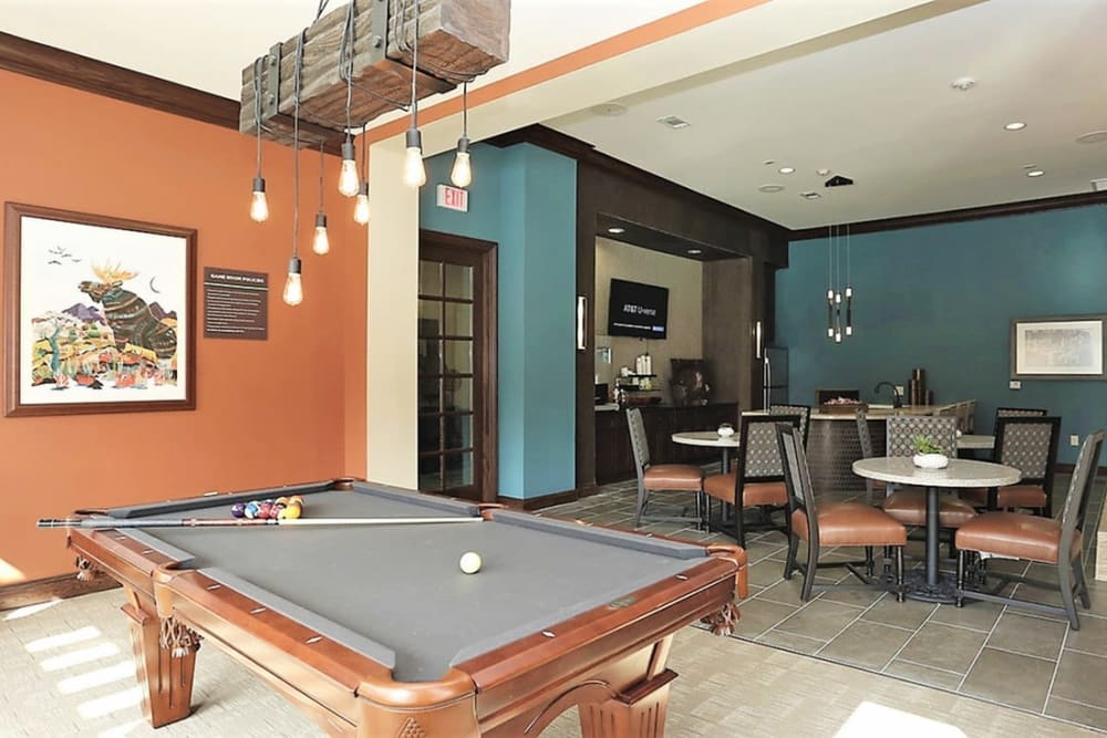 Resident clubhouse with a billiards table and seating at Trails at Lake Houston in Houston, Texas