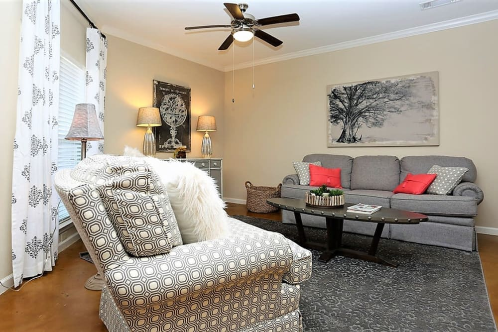 Living room with a ceiling fan at Trails at Lake Houston in Houston, Texas