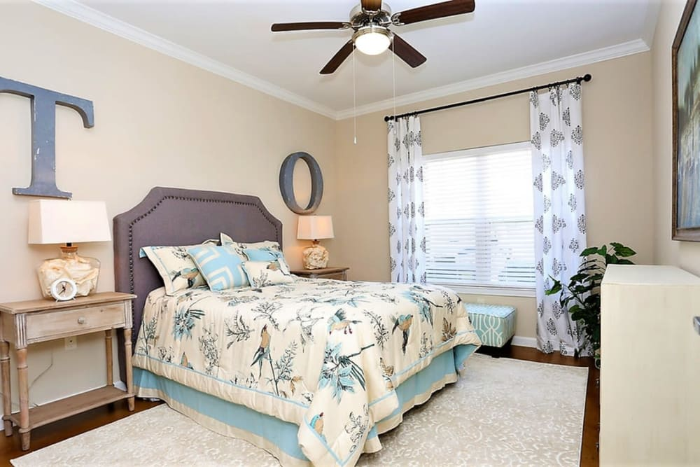 Spacious master bedroom with ceiling fan at Trails at Lake Houston in Houston, Texas