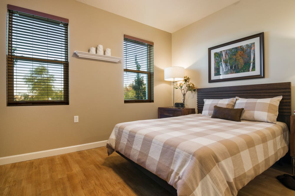 Resident bedroom with windows at CERTUS Premier Memory Care Living in Orlando, Florida.