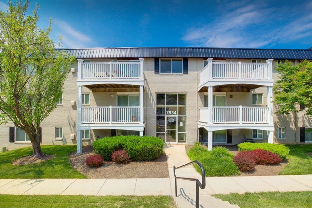 Apartment exterior with surrounding walkway at The Blvd at White Springs in Nottingham, Maryland