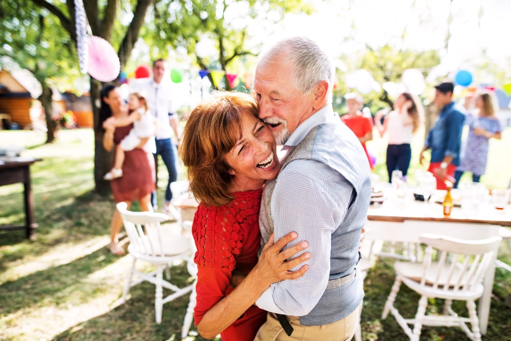 A resident couple having fun at a party near The Claiborne at Brickyard Crossing in Summerville, South Carolina.