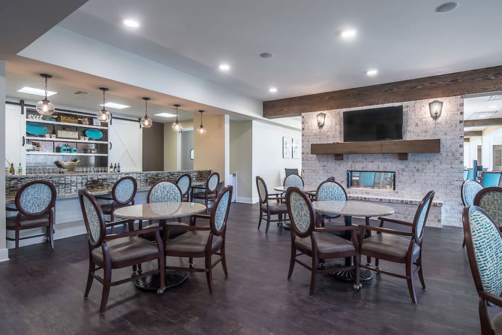 Spacious dining room with a TV at The Claiborne at Shoe Creek in Baton Rouge, Louisiana.