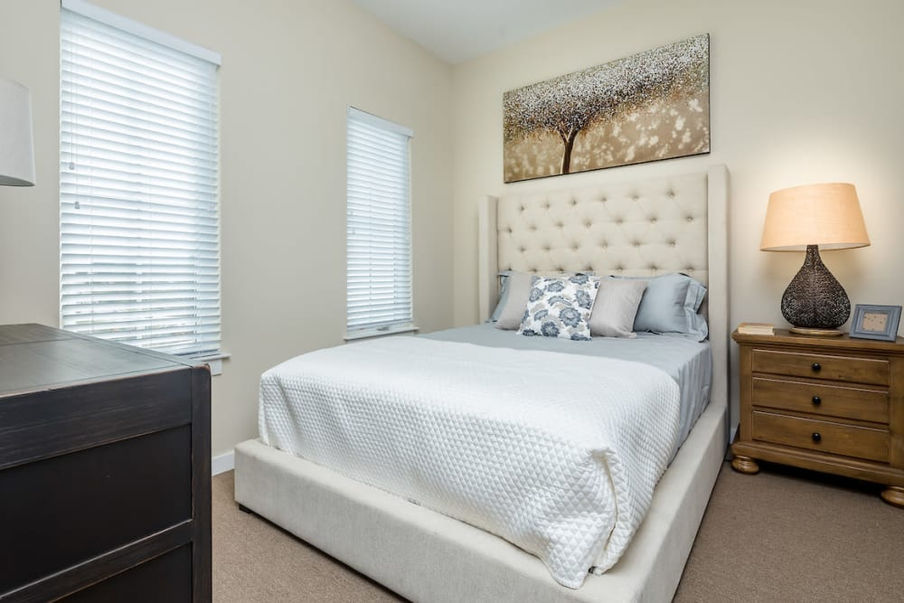 Resident bedroom with windows at The Claiborne at Shoe Creek in Baton Rouge, Louisiana.