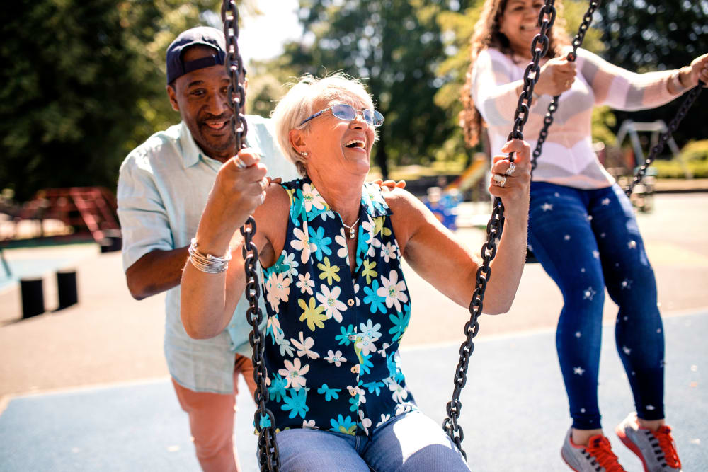 A resident swinging at The Claiborne at Hattiesburg Independent Living in Hattiesburg, Mississippi.