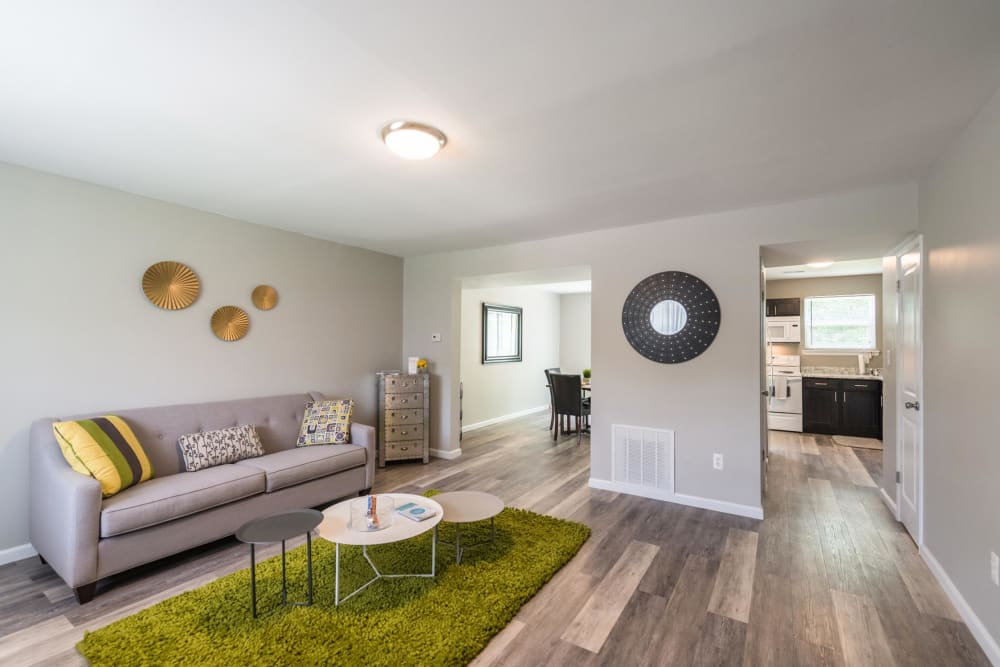 An apartment living room, dining room and kitchen at The Springs in Parkville, Maryland