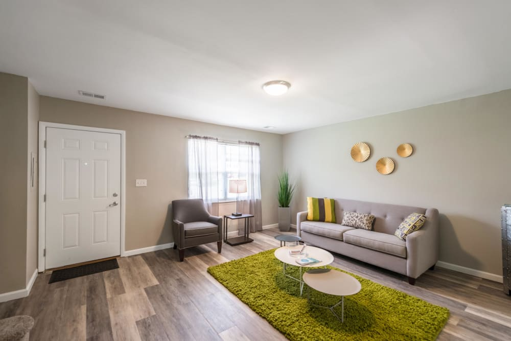 An inviting living room in a a model apartment at The Springs in Parkville, Maryland