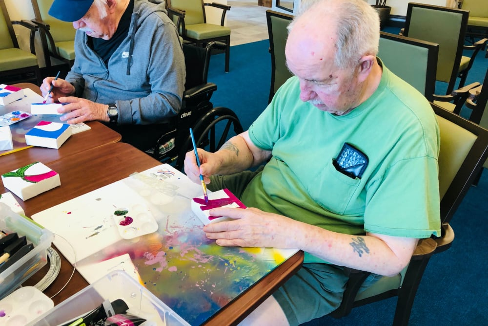 A resident painting at CERTUS Premier Memory Care Living in Mount Dora, Florida.
