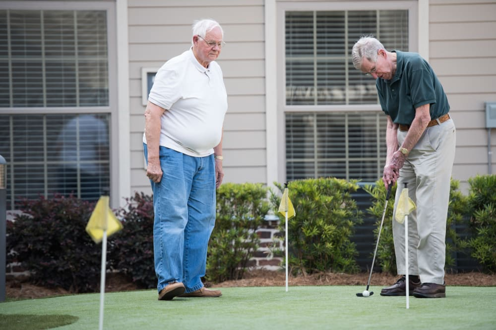 Residents playing on the putting green at The Claiborne at Hattiesburg Independent Living in Hattiesburg, Mississippi