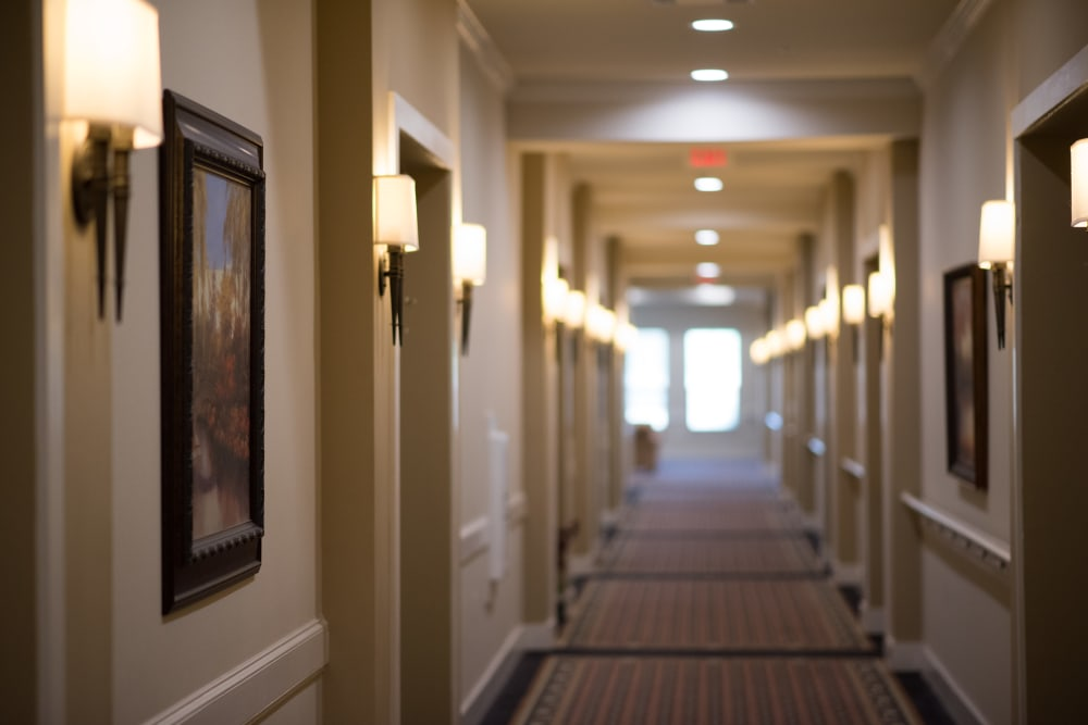 Wide quiet hallways are easy to navigate at The Claiborne at Hattiesburg Assisted Living in Hattiesburg, Mississippi