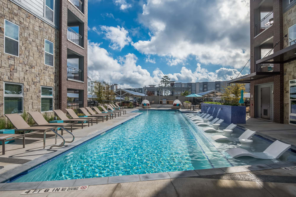Sparkling resort-worthy swimming pool at Enclave at Woodland Lakes in Conroe, Texas