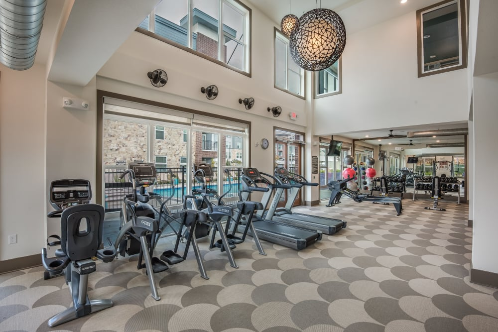 Fully equipped fitness center at Enclave at Woodland Lakes in Conroe, Texas