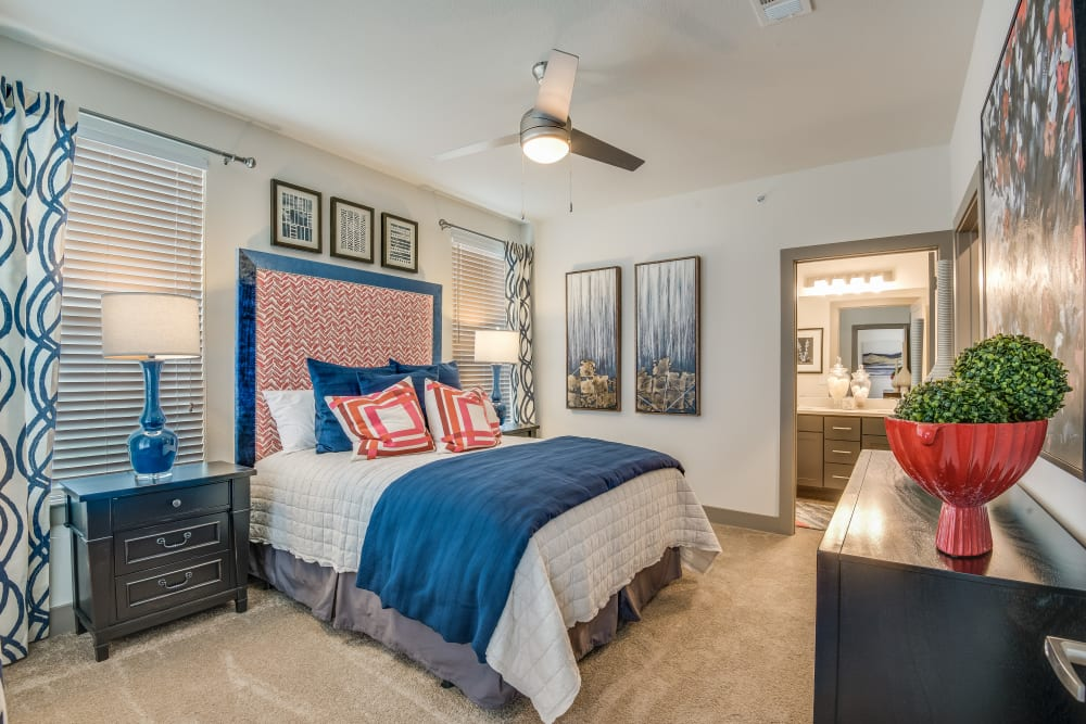 Well decorated bedroom at Enclave at Woodland Lakes in Conroe, Texas