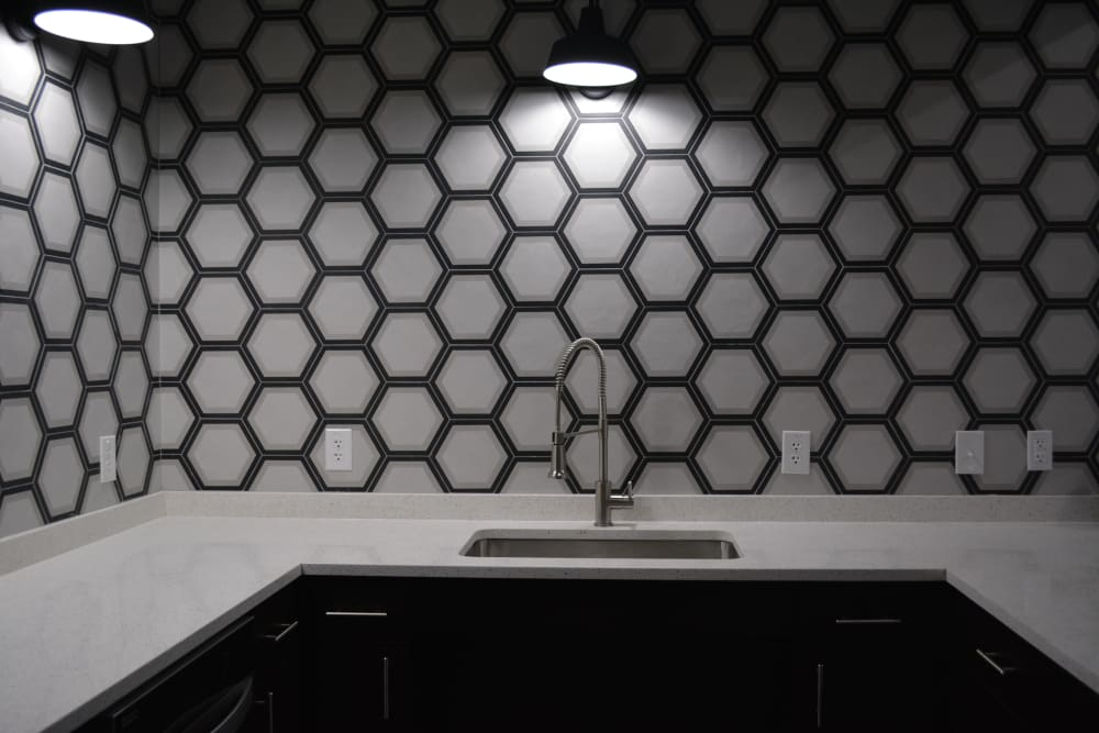 Modern style kitchen with patterned backsplash at The Abbey at Sonterra in San Antonio, Texas