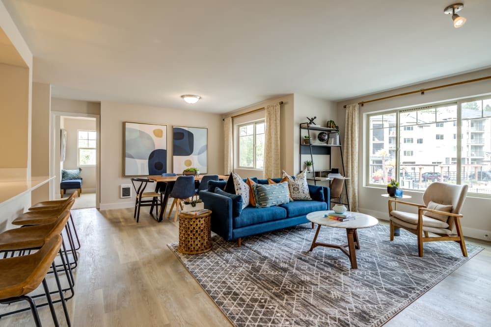 Open floor plan living room with large windows at Vue Issaquah in Issaquah, Washington