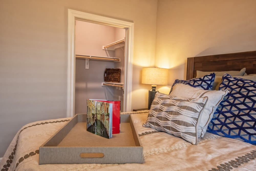 Model bed and closet at Artistry at Craig Ranch in McKinney, Texas