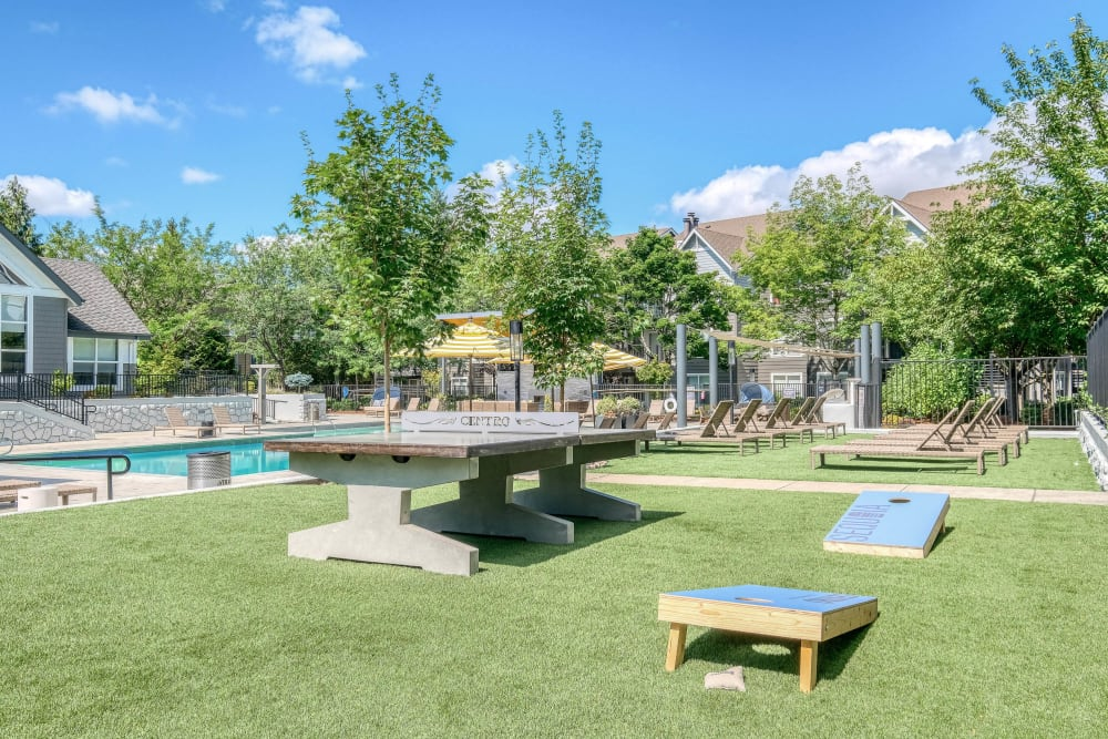 Cornhole, ping pong, and more at the outside game area near the pool at Centro Apartment Homes in Hillsboro, Oregon