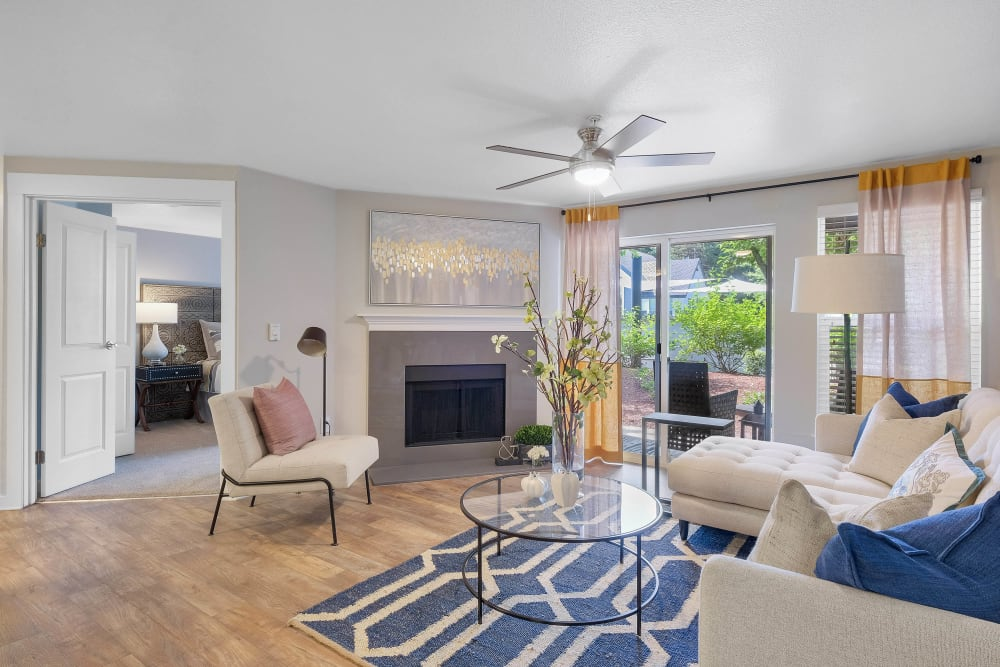 Spacious open-concept living area with a ceiling fan in a model home at Centro Apartment Homes in Hillsboro, Oregon