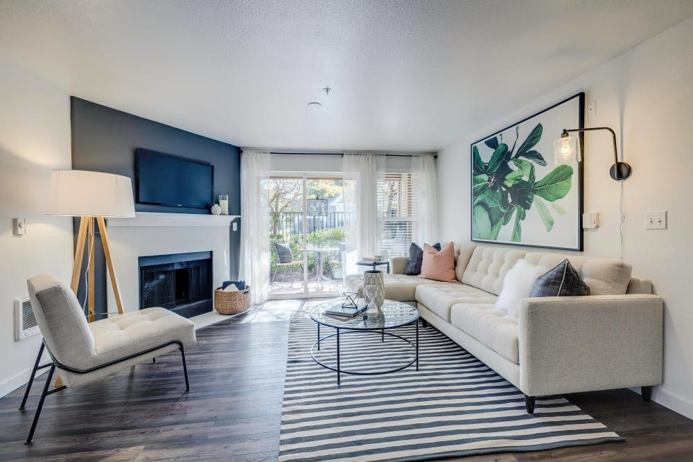 Fireplace with quartz surround in a model home's living area at Centro Apartment Homes in Hillsboro, Oregon