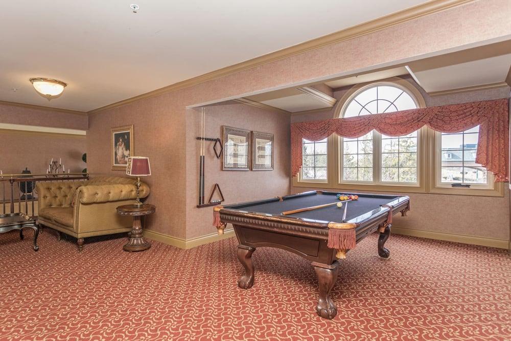A game room with billiard table at Central Park Estates in Novi, Michigan
