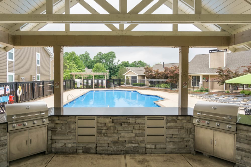 The swimming pool and grill area at Paddock Club Apartments in Florence, Kentucky