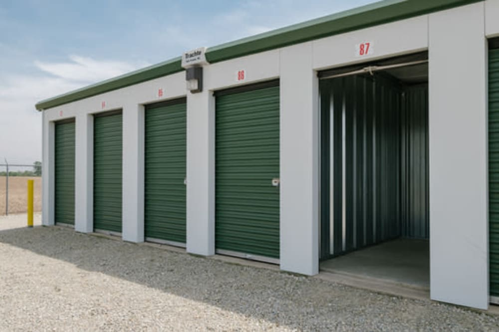 Garage style roll up doors on self storage units at StayLock Storage in Farmland, Indiana