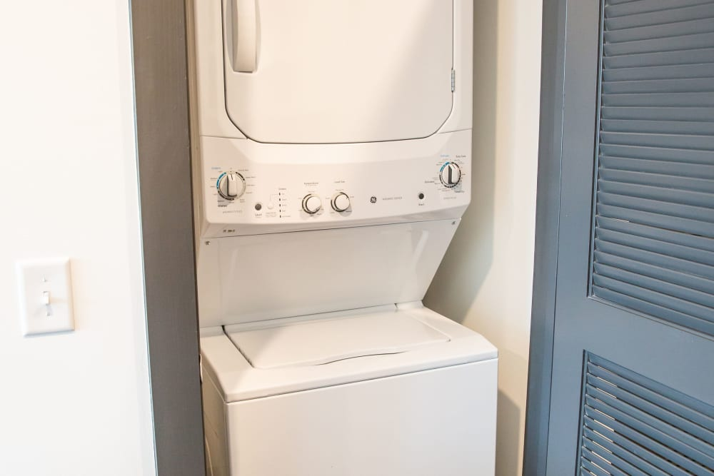 An apartment washer and dryer combo at Belcourt Park in Nashville, Tennessee