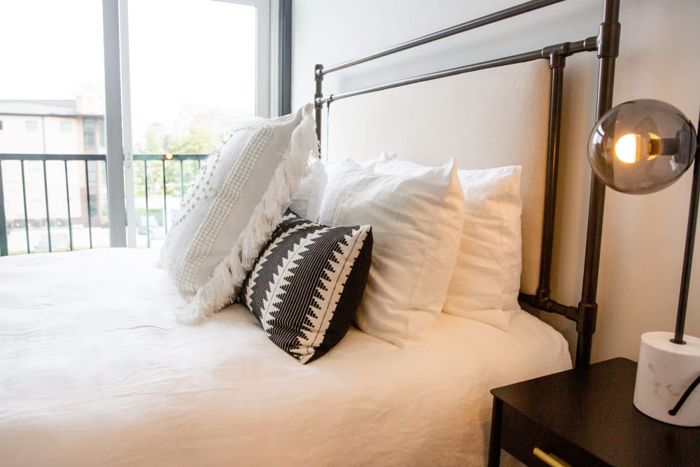 A bed with throw-pillows at Belcourt Park in Nashville, Tennessee