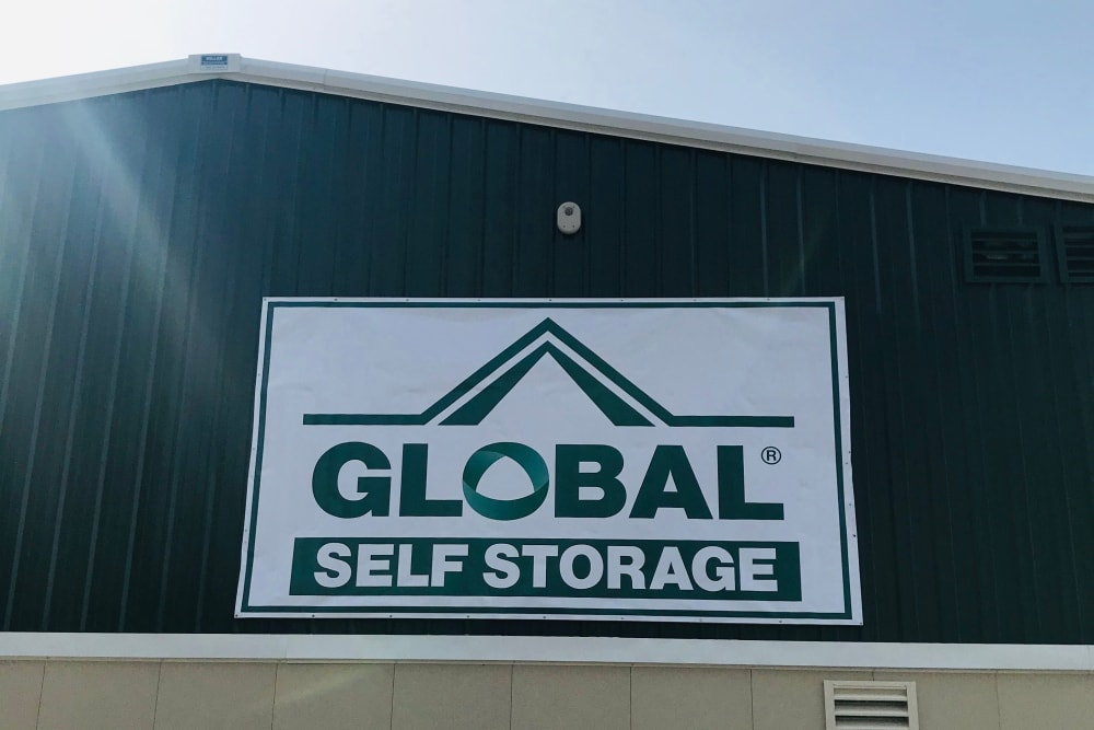 Outdoor sign at Global Self Storage in Millbrook, NY
