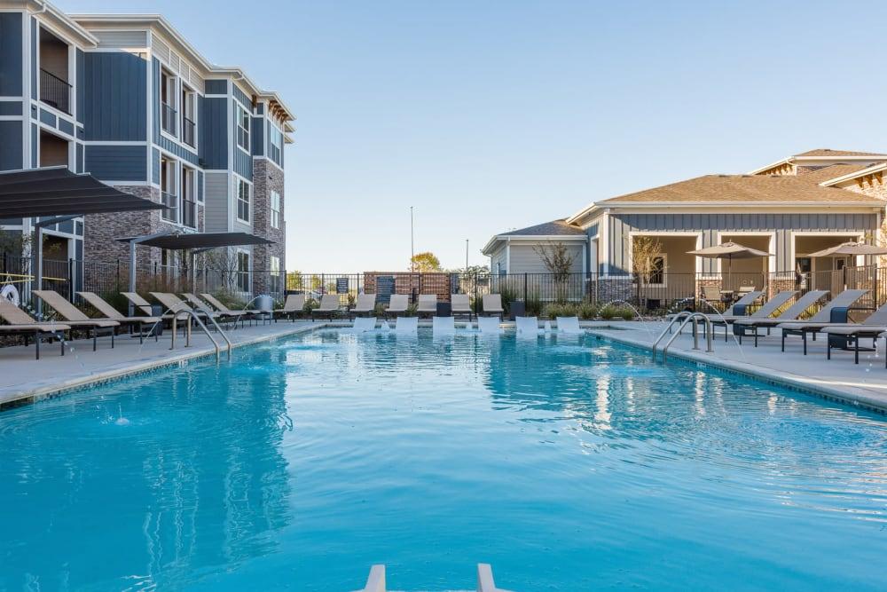 Resort-style swimming pool at Enclave at Westport in Roanoke, Texas