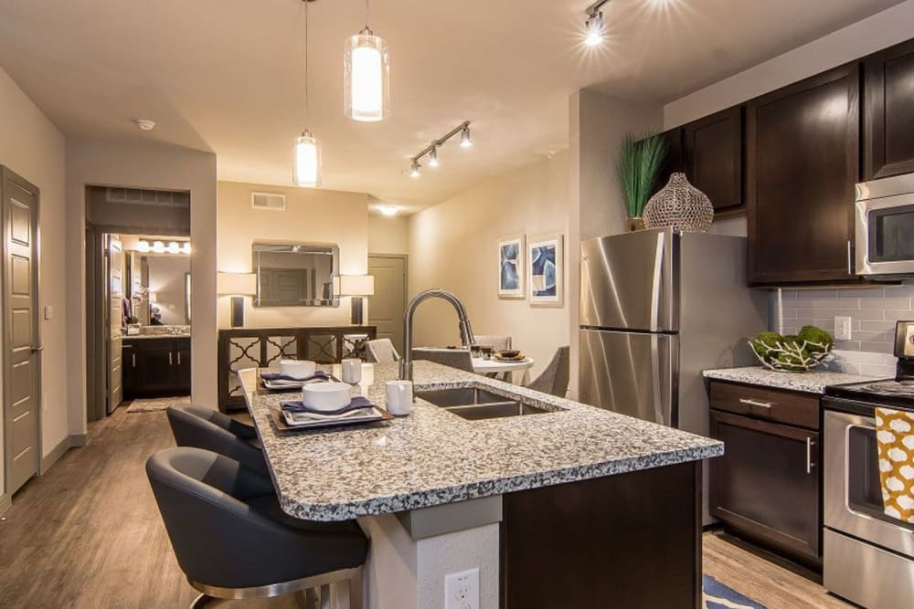 Fully equipped kitchen at Enclave at Westport in Roanoke, Texas