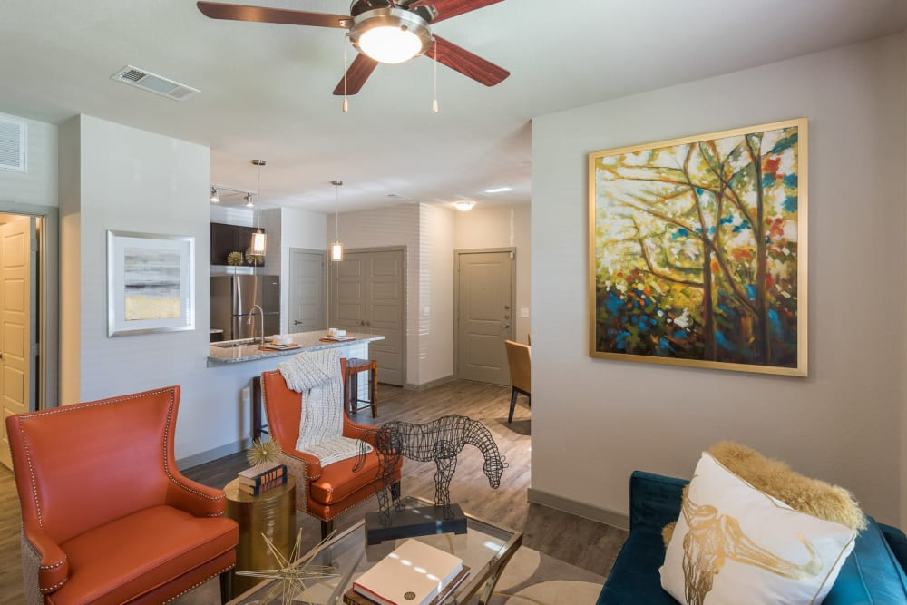 Living room with ceiling fan at Enclave at Westport in Roanoke, Texas