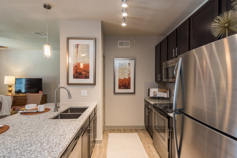 Spacious, bright kitchen at Enclave at Westport in Roanoke, Texas