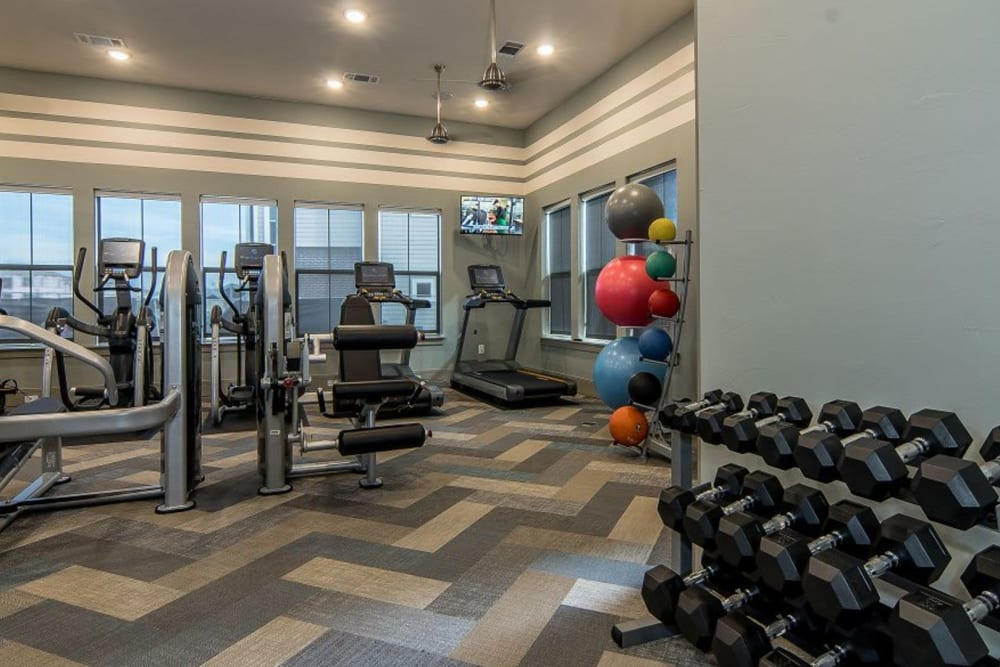 Free weights at Enclave at Westport's fitness center in Roanoke, Texas