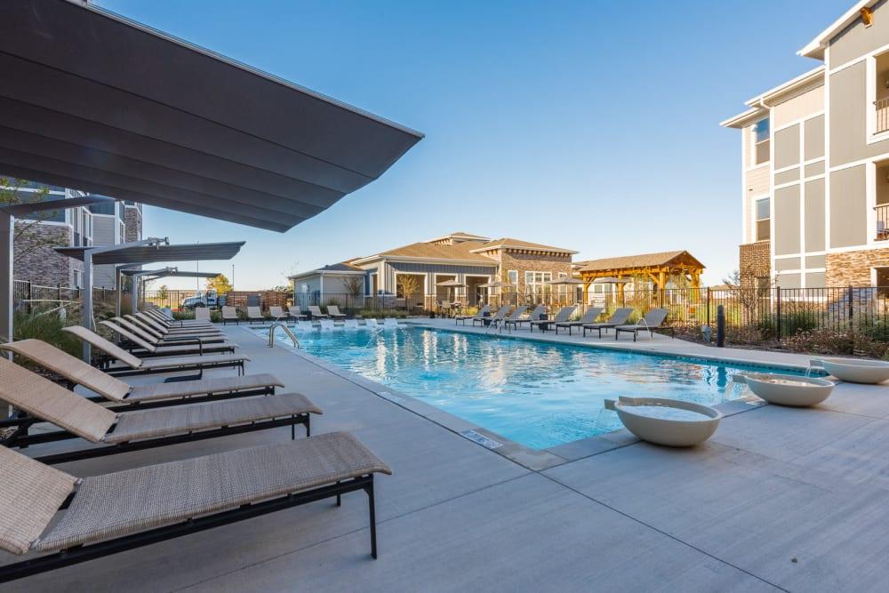 Resort-style sparkling swimming pool at Enclave at Westport in Roanoke, Texas