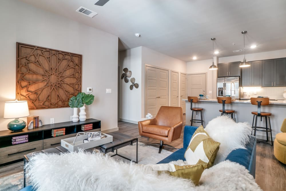 Bright well decorated living room at One90 Firewheel in Garland, Texas