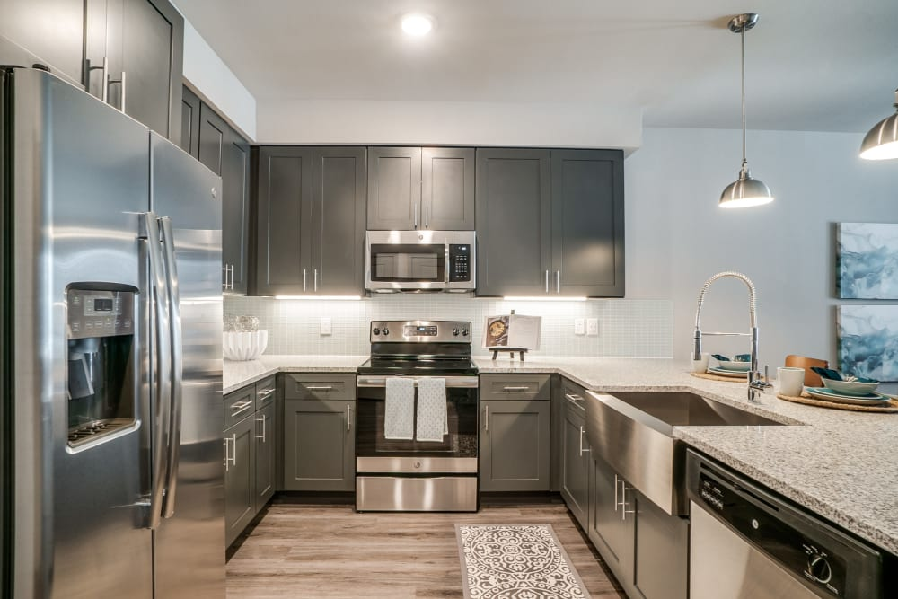 Kitchen with stainless steel appliances at One90 Firewheel in Garland, Texas